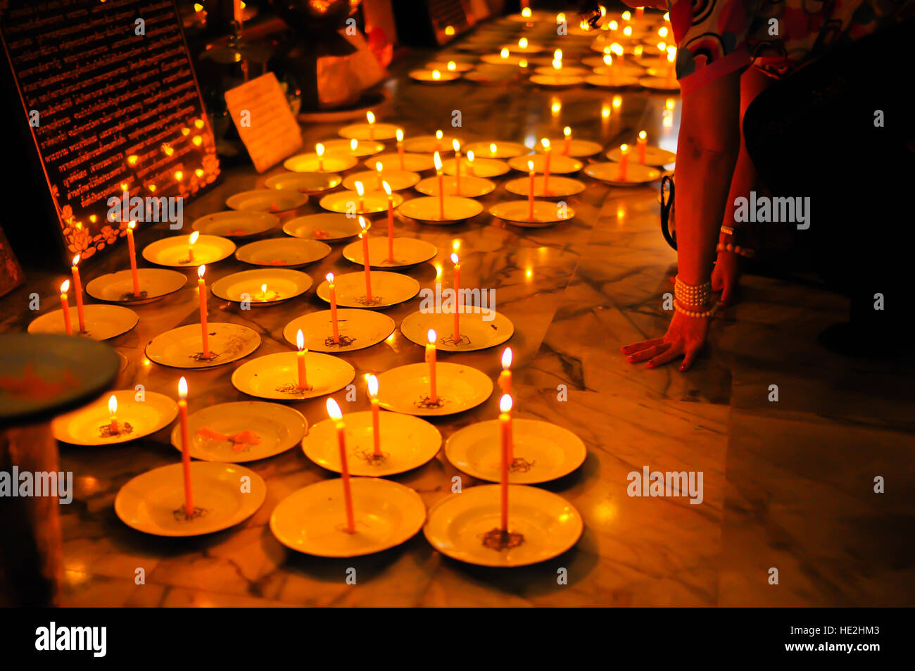 Candle in a temple in Thailand Stock Photo