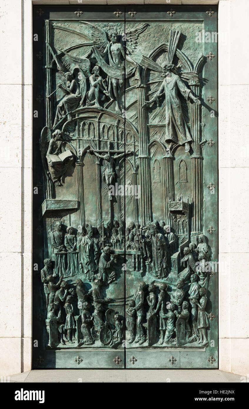 Almudena Cathedral, Santa María la Real de La Almudena. Detail of bronze doors at entrance. Madrid, Spain. - Stock Image