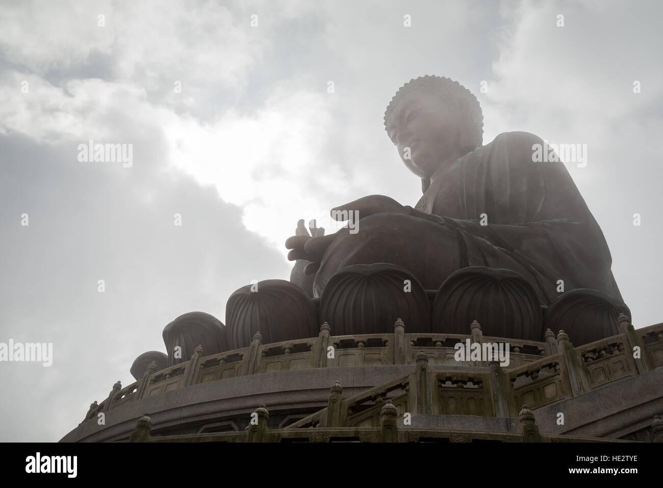 Silhouette of the Tian Tan Buddha (Big Buddha) statue on Lantau Island in Hong Kong, China. - Stock Image