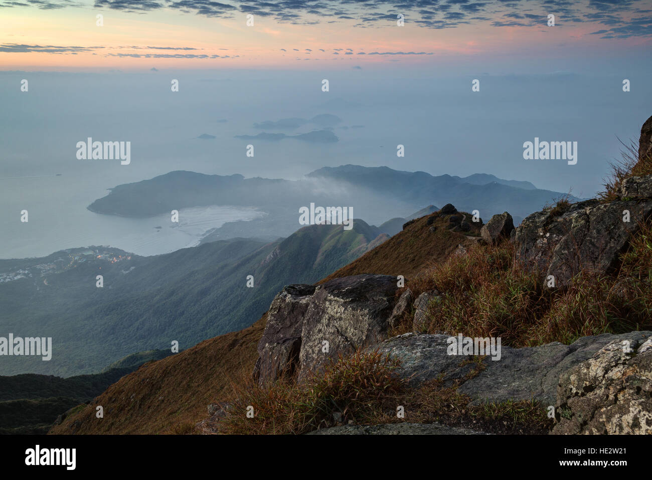 View of the coastline and hills on the Lantau Island from above, viewed from the Lantau Peak on Lantau Island in - Stock Image