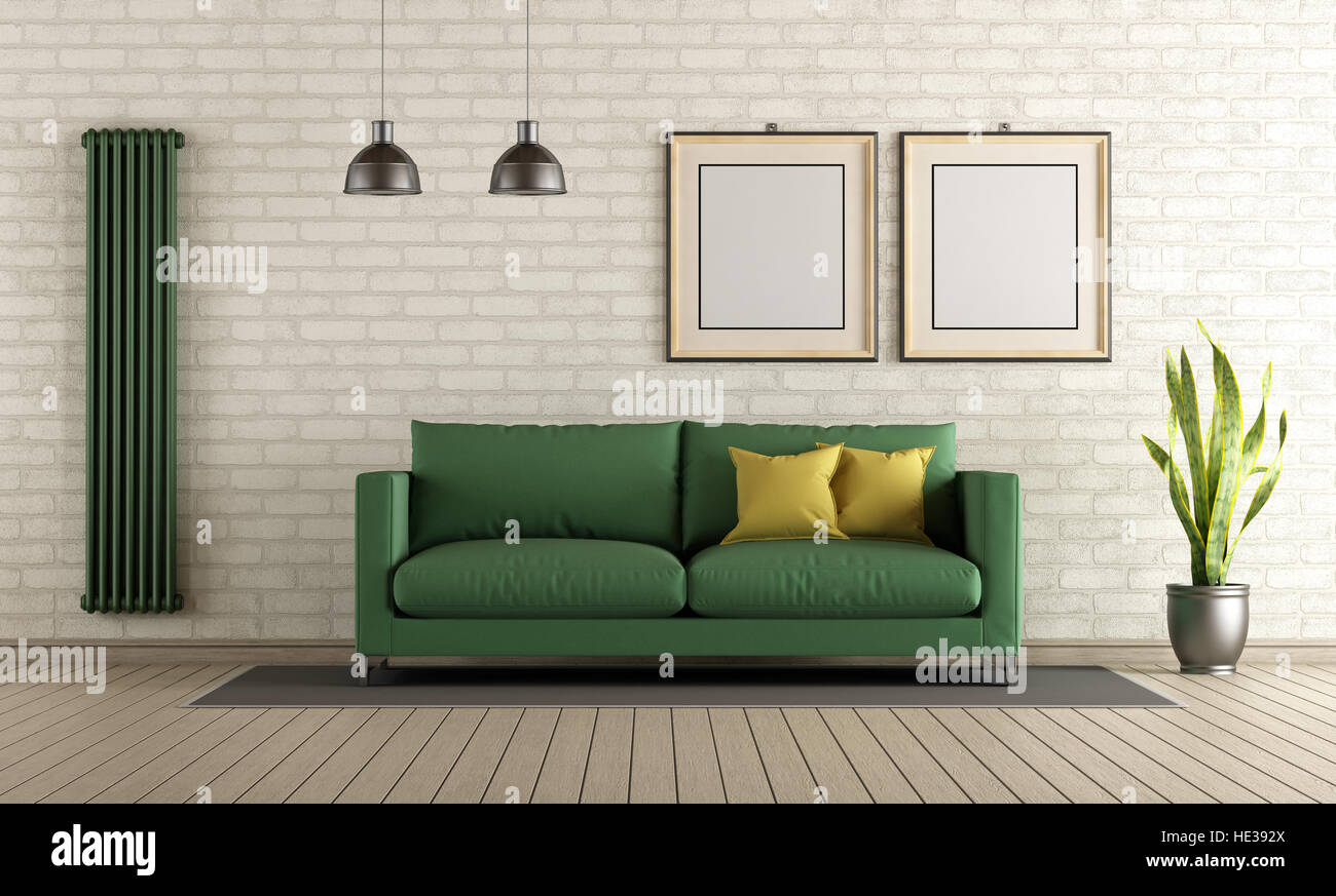 Modern living room with green sofa and vertical heater on brick wall ...