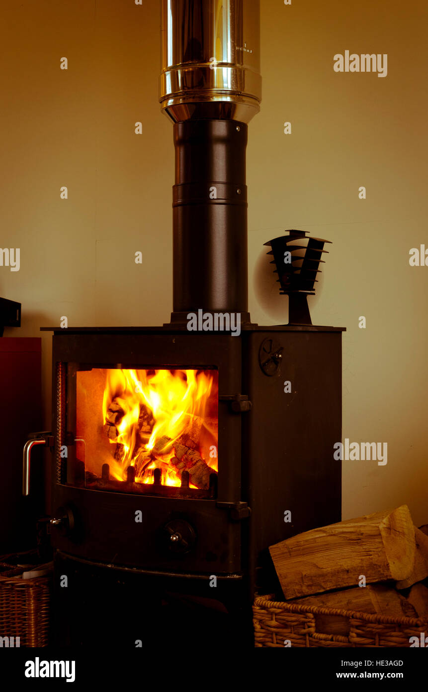 hygge woodburner heating a cosy warm home. - Stock Image
