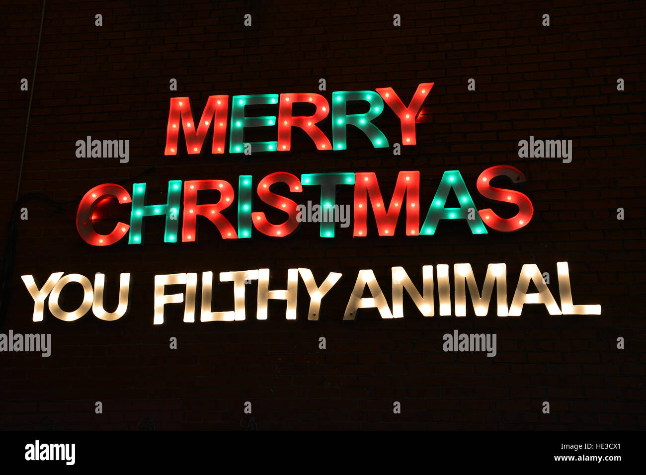 large merry christmas sign in the bishop arts neighborhood of dallas texas stock