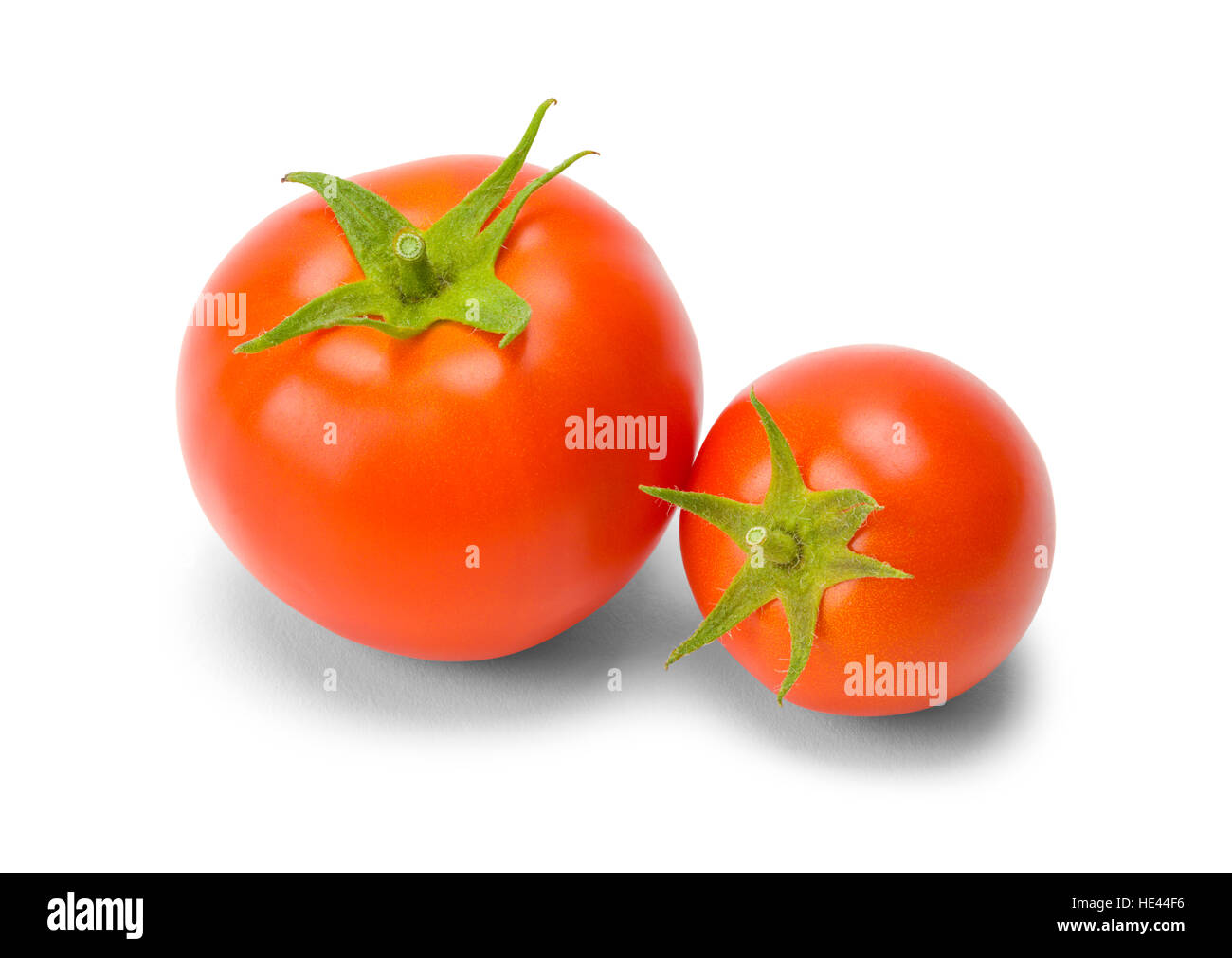 Two Red Tomatoes Different Sizes Isolated on White Background. - Stock Image
