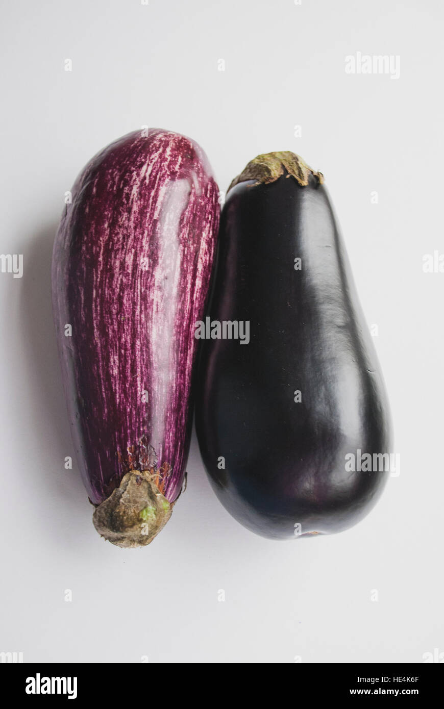 Two purple eggplants aubergines on white background - Stock Image