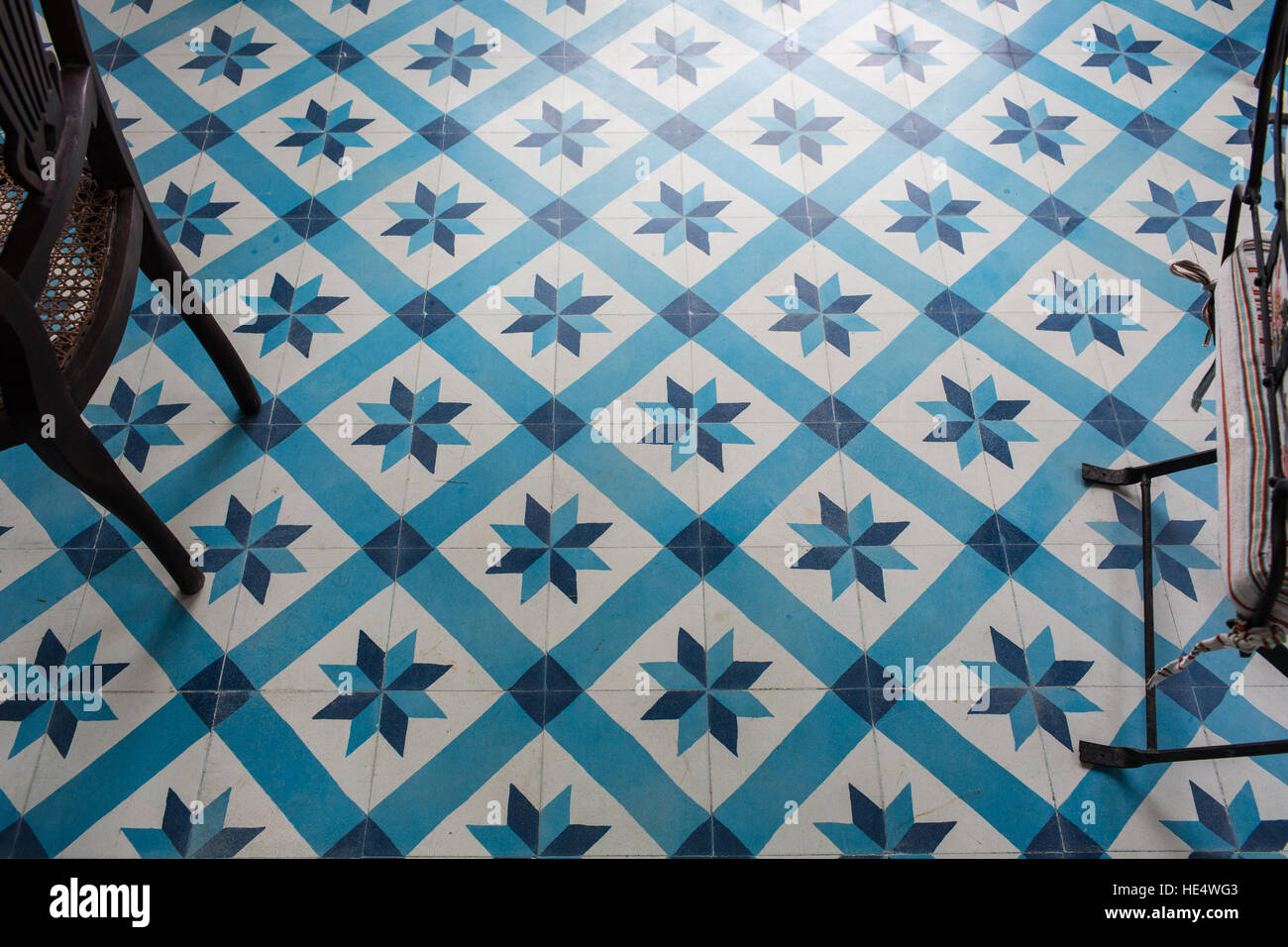 Modern floor tiles with blue colored geometric design in a ...
