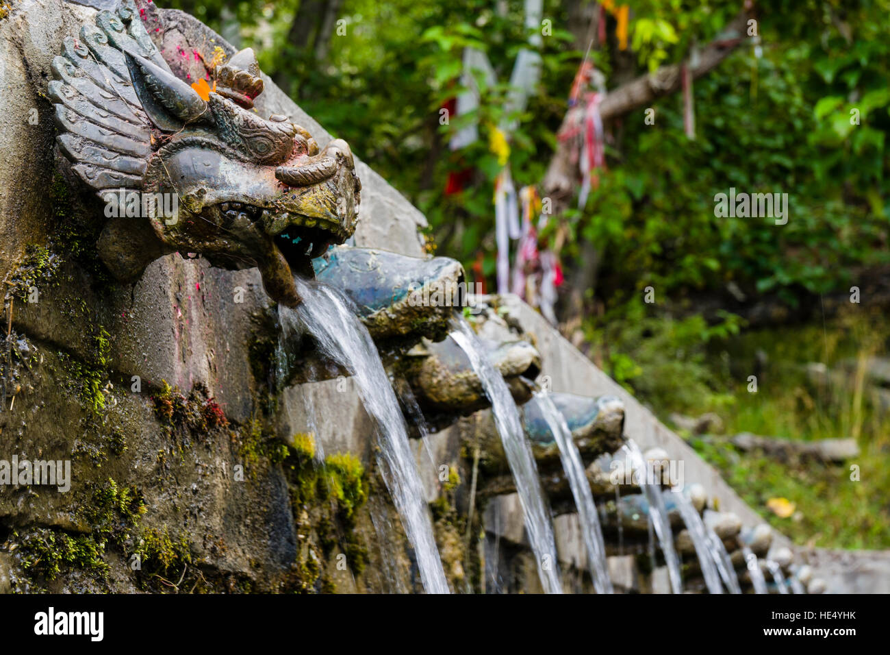 The sacred water flows out of 108 pipes around the temple complex - Stock Image