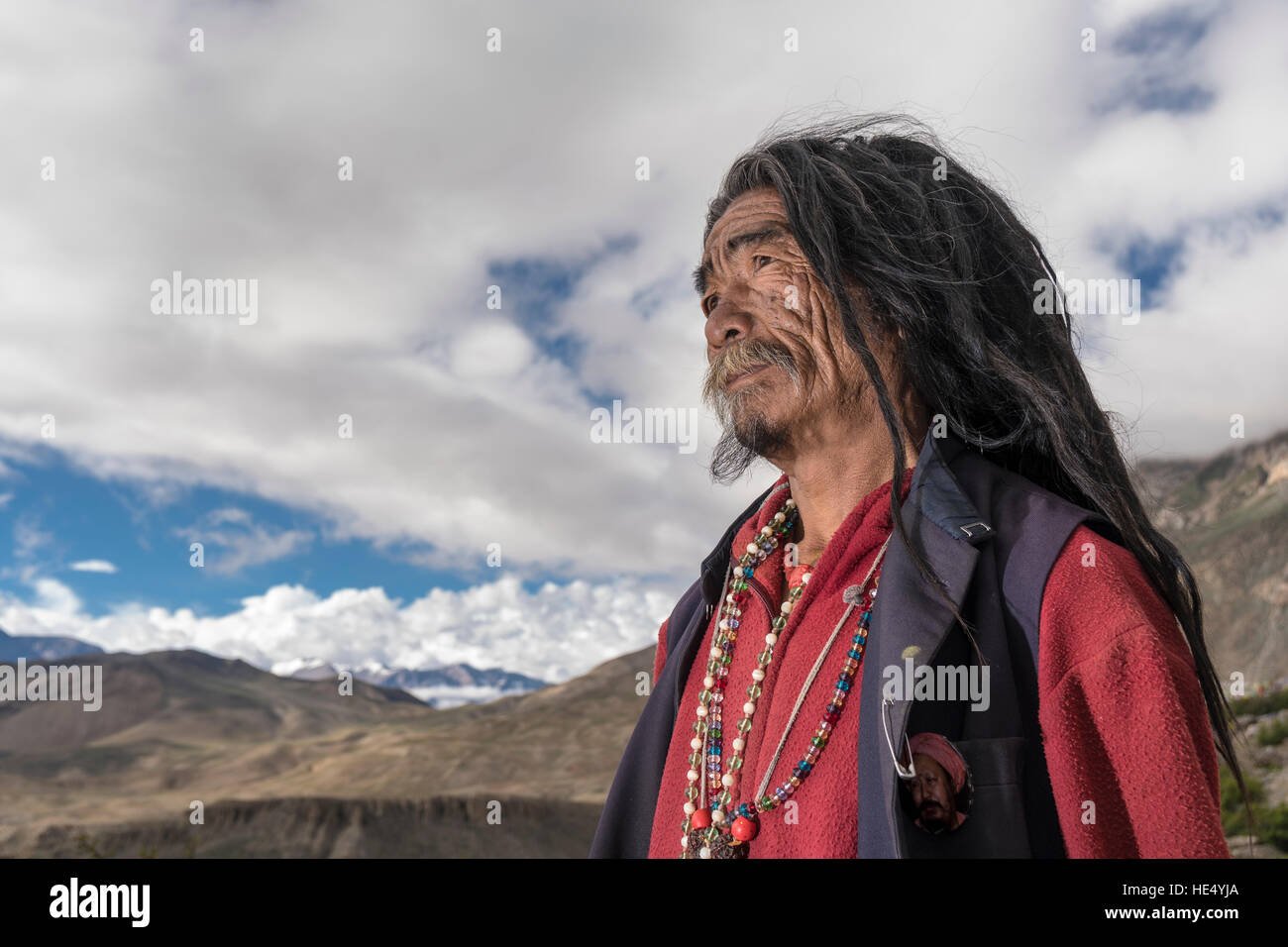 A portrait of a Sadhu, holy man, looking into the himalayan mountains Stock Photo