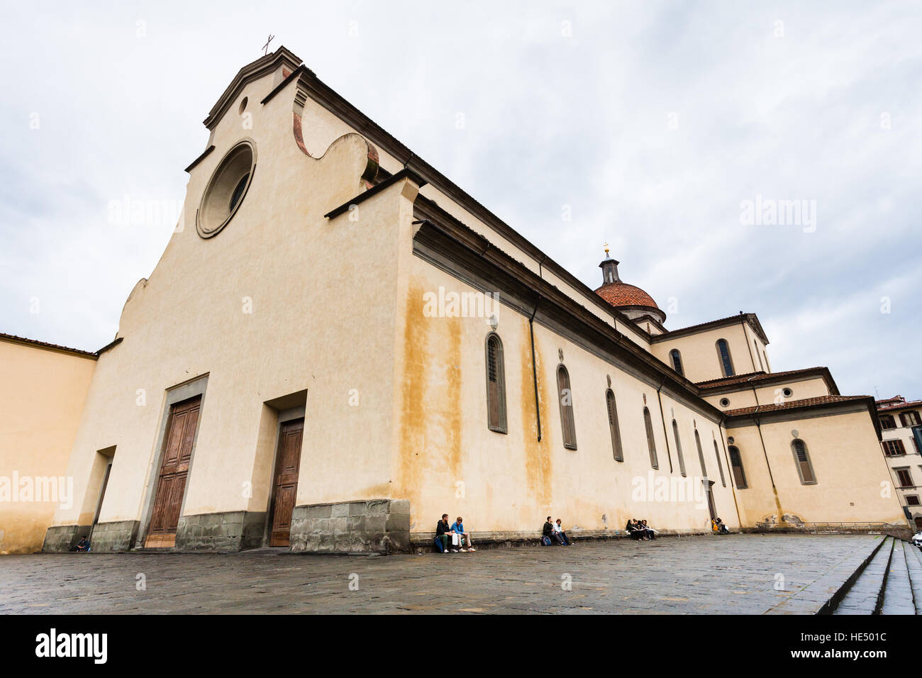 FLORENCE, ITALY - NOVEMBER 5, 2016: People near Basilica di Santo Spirito (Basilica of the Holy Spirit) in Florence - Stock Image
