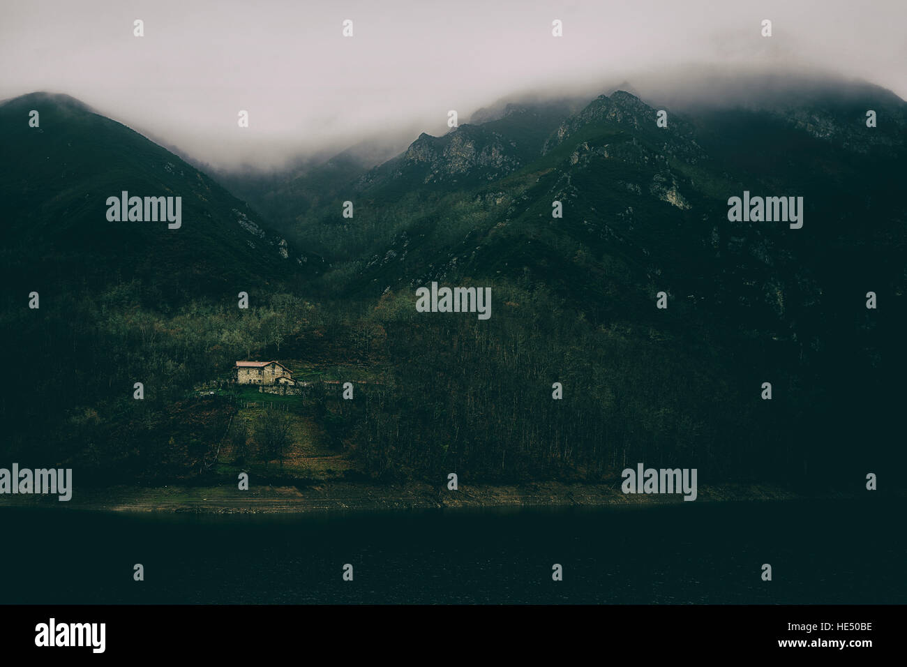 lonely house in the mountains, an isolated place perfect to get lost and find yourself - Stock Image