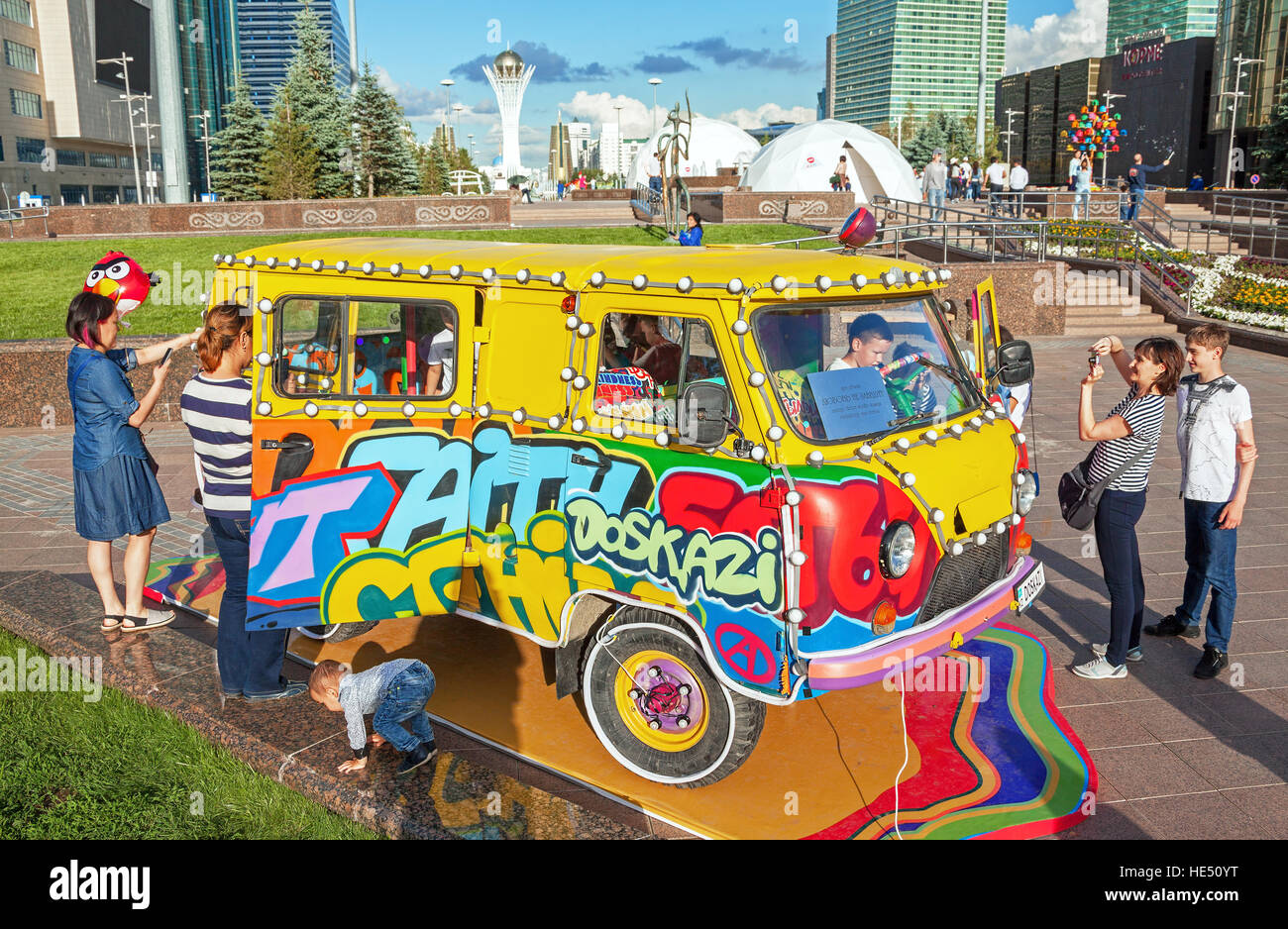 ASTANA, KAZAKHSTAN - JULY 03, 2016: art installation on the background of the famous Bayterek tower in downtown - Stock Image