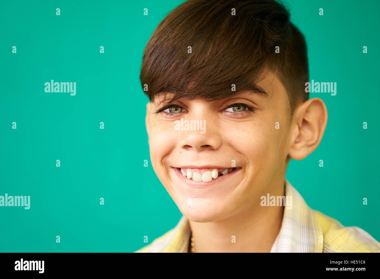 Real Cuban people and feelings, portrait of happy young latino kid from Havana, Cuba looking at camera and smiling. - Stock Image