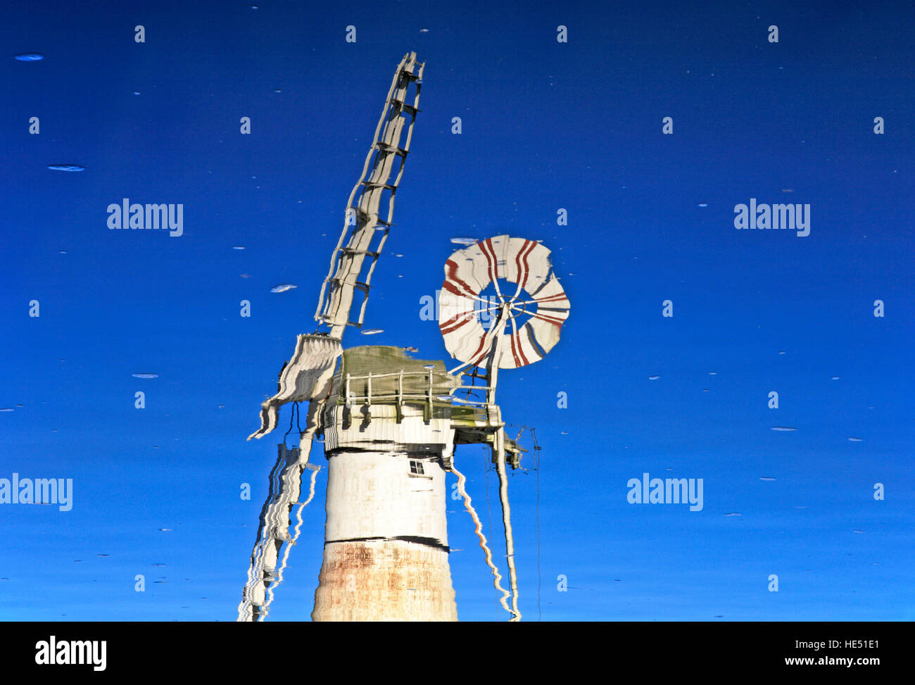 A reflection of Thurne Dyke Drainage mill on the Norfolk Broads. Stock Photo