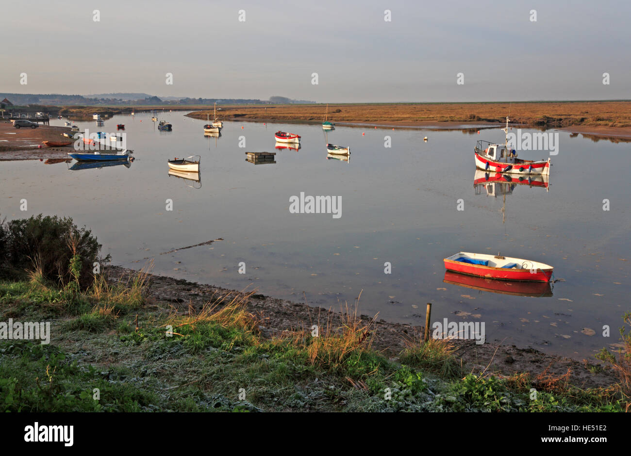 Boats anchored on a December morning at Burnham Overy Staithe, Norfolk, England, United Kingdom. - Stock Image