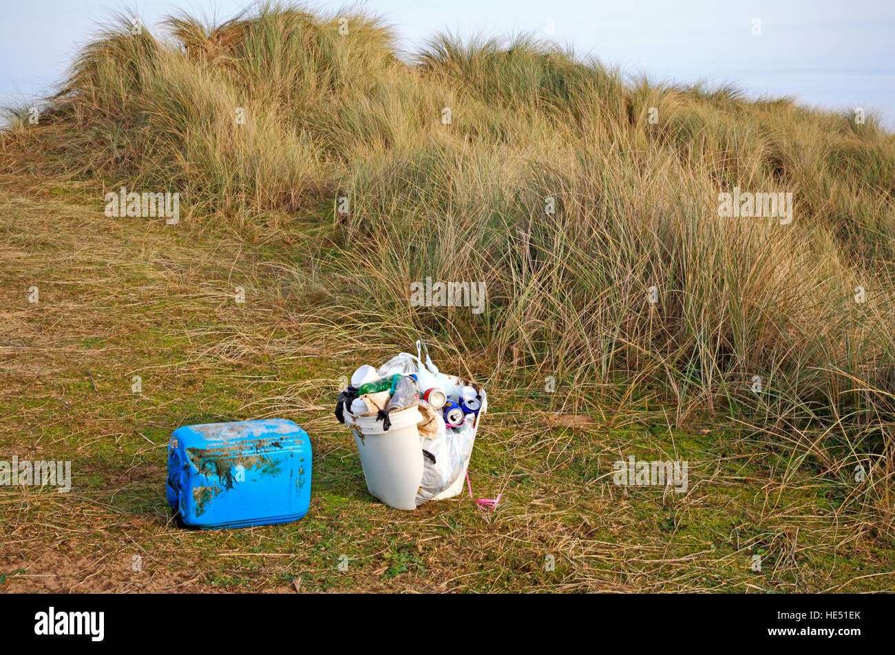 Rubbish collected in sand dunes in an Area of Outstanding Natural Beauty at Burnham Overy, Norfolk, England, United - Stock Image