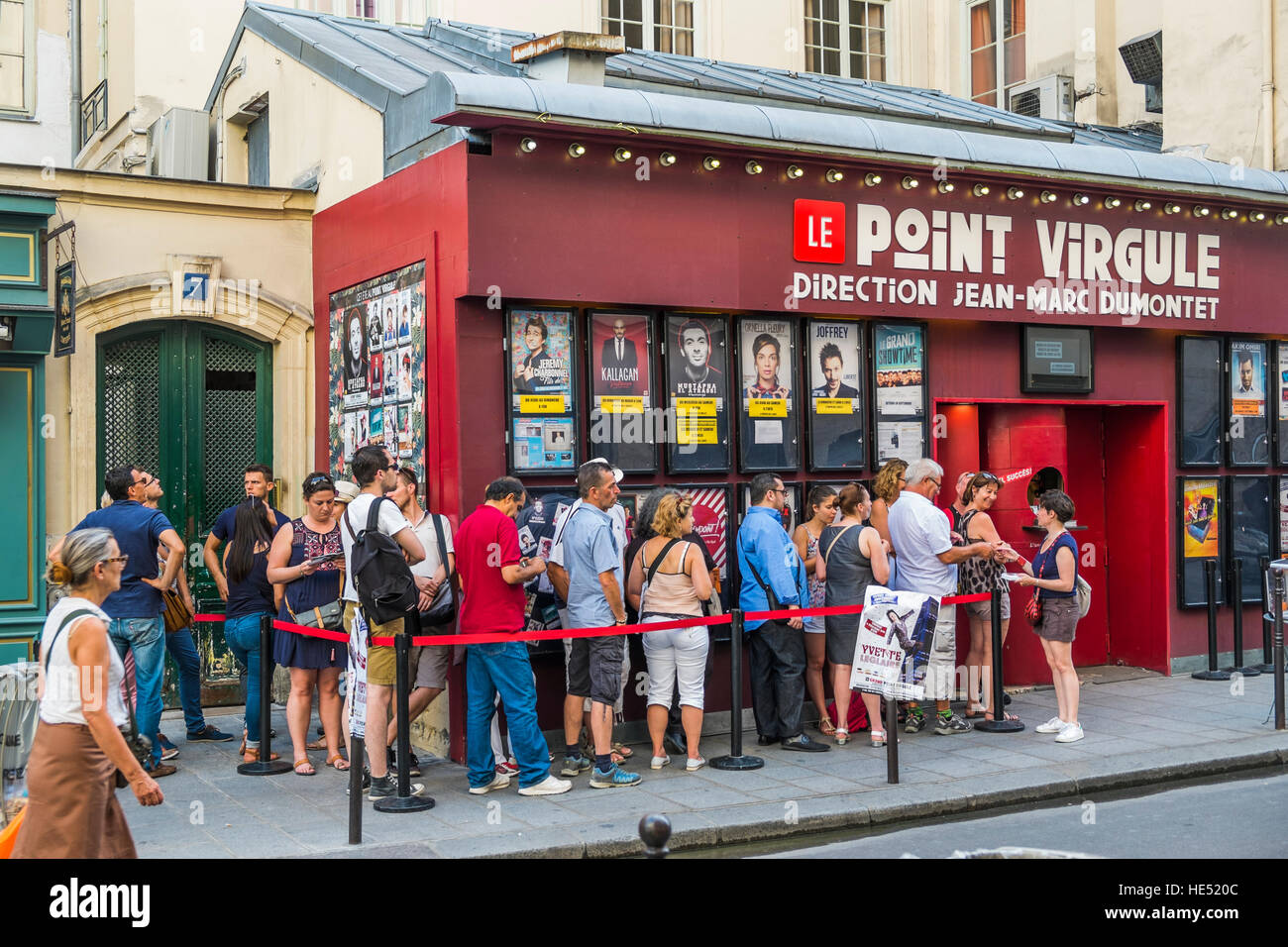people lining up for tickets on a saturday night at le point  virgule theater - Stock Image