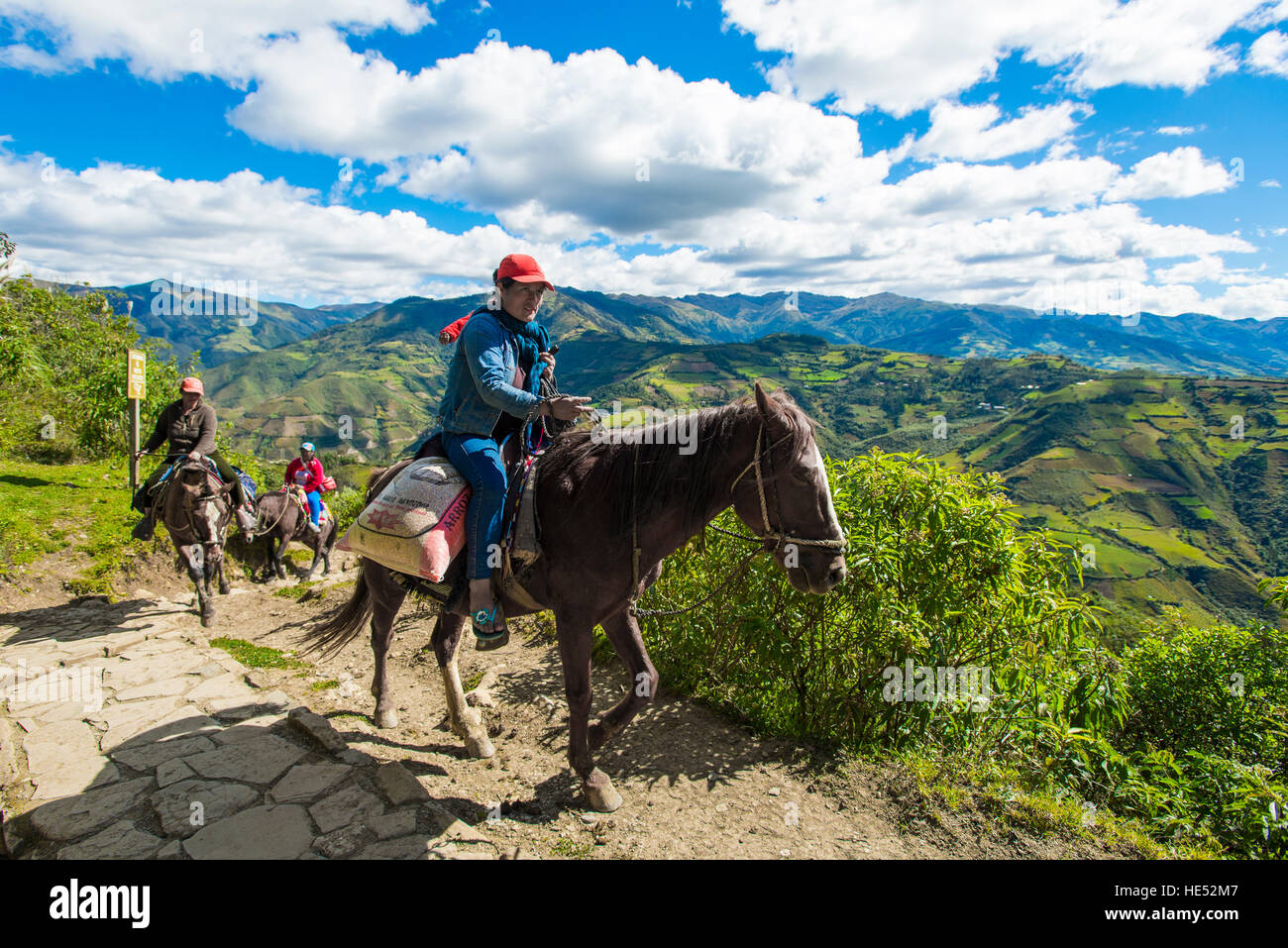 Horse riders on narrow path, Chachapoyas, Luya Province, Andes, Peru - Stock Image