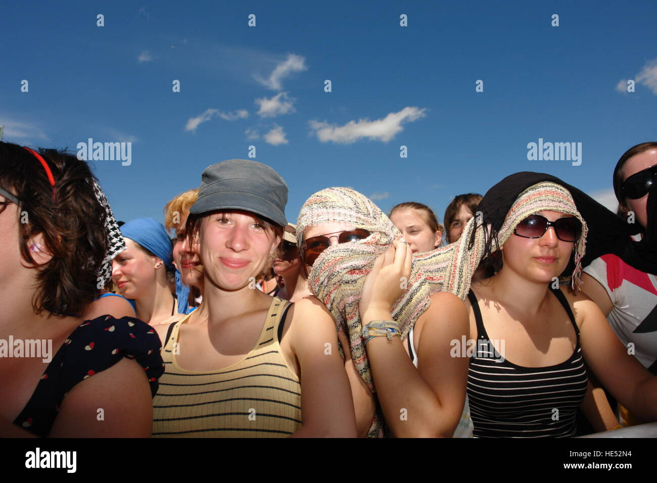 People at Southside, open-air festival, using all sorts of things to protect their skin from the sun on a very hot - Stock Image