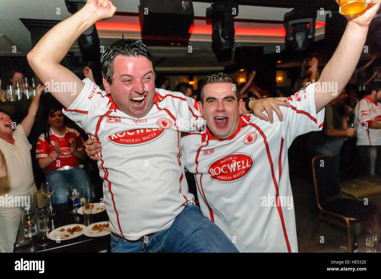 People in Cookstown celebrate County Tyrone (Tir Eoghan) winning the All Ireland Gaelic Football championship. 21 - Stock Image