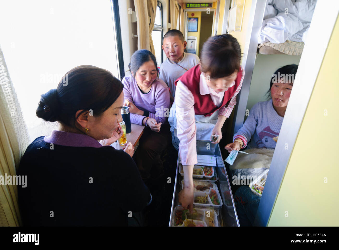 : Railway line to Tibet (Lhasa); Tibetans on pilgrimage to the Tibetan New Year festival in Lhasa; Sale of lunch, Stock Photo
