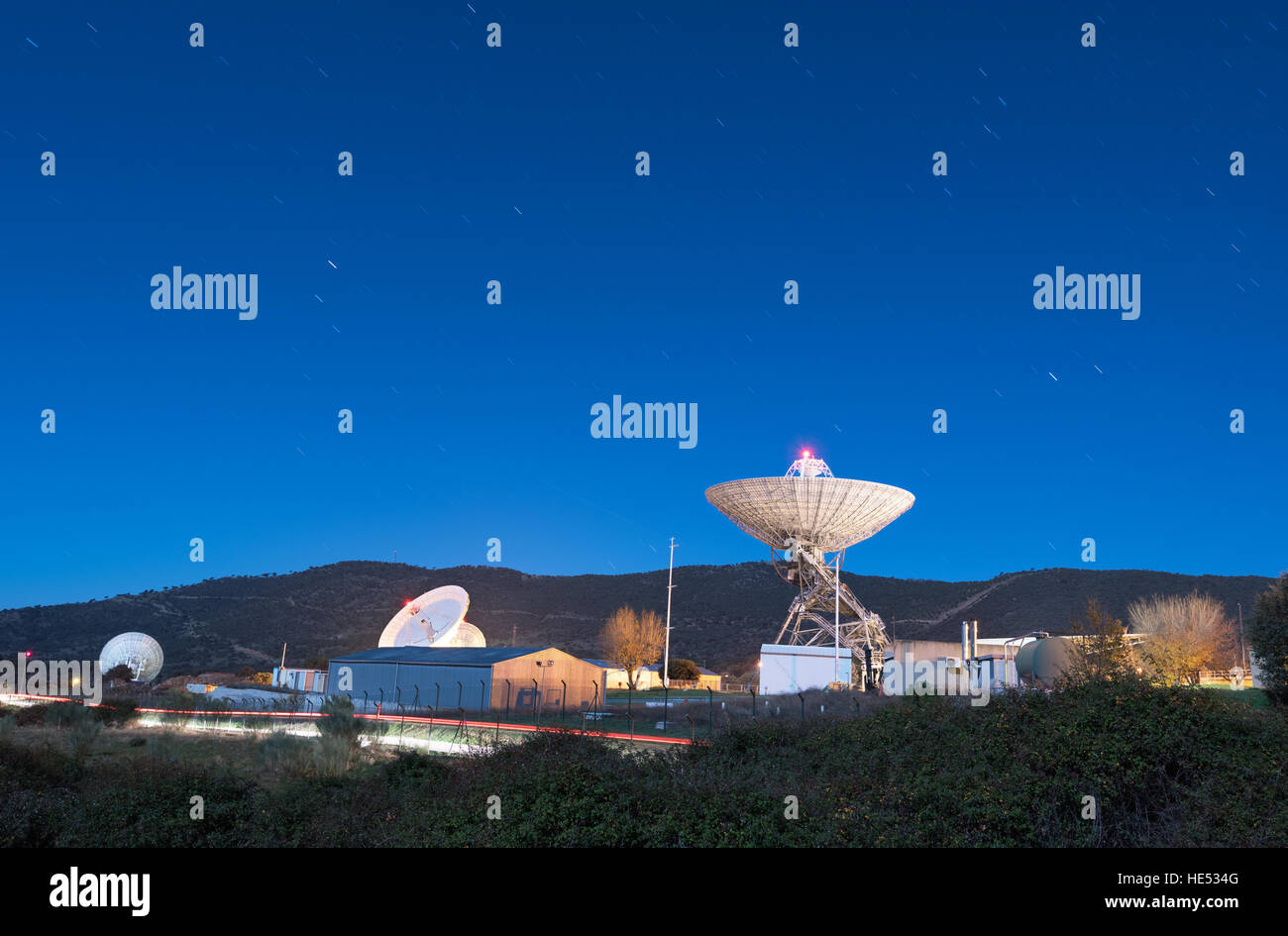 Night scene of Madrid Deep Space comunication complex. It is part of NASA's Deep Space Network run by the Jet - Stock Image