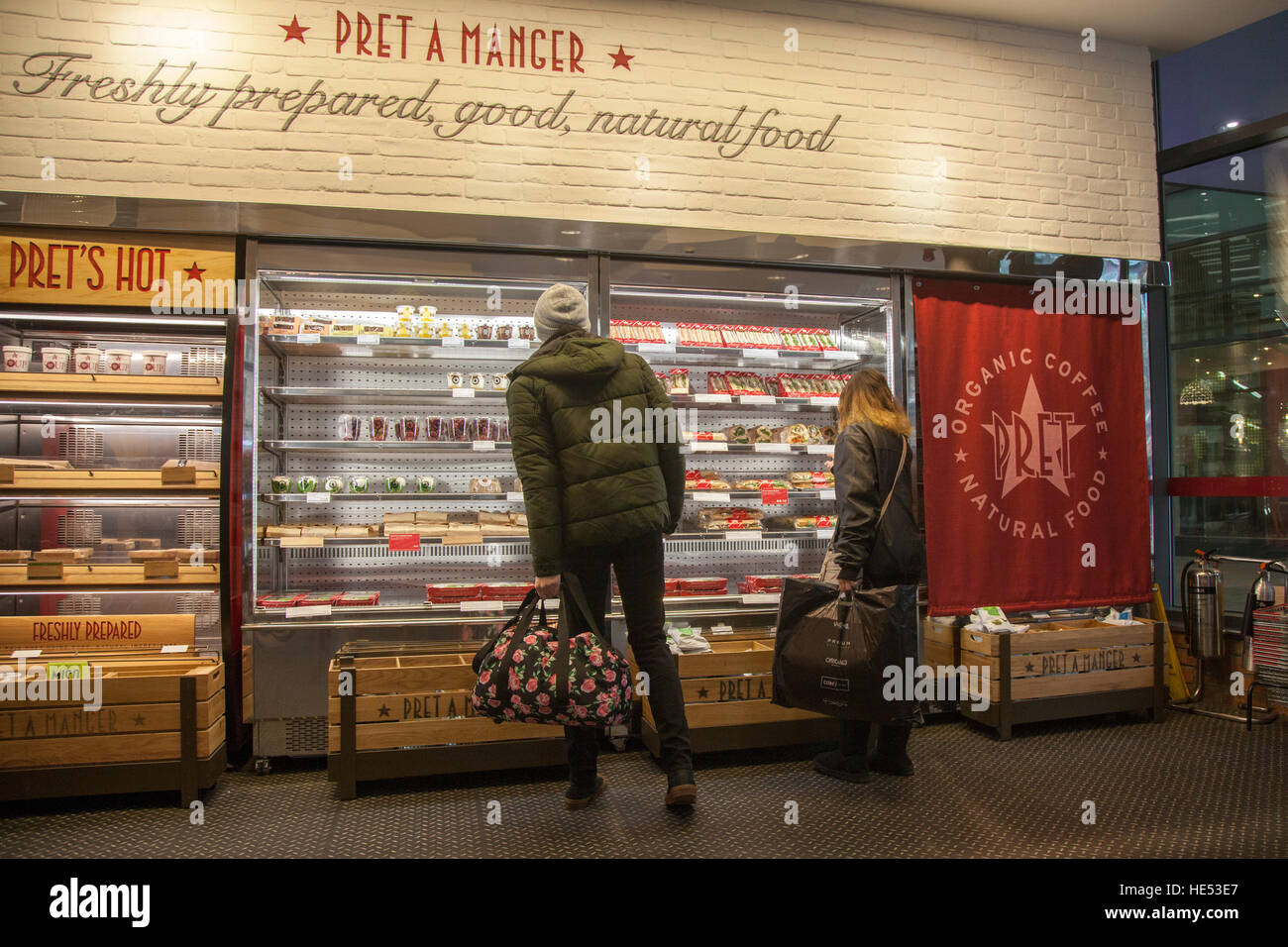 Pret a Manger, patrons selecting freshy prepared, good, natural food, Cafe in Manchester, UK Stock Photo
