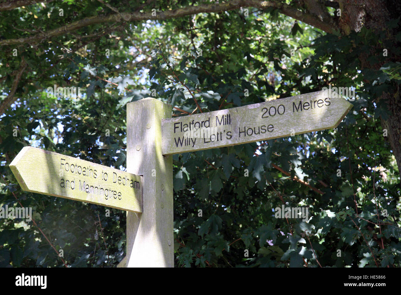 Sign post showing the distance to Flatford Mill and Willy Lott's house, the scene for John Constables painting the Stock Photo