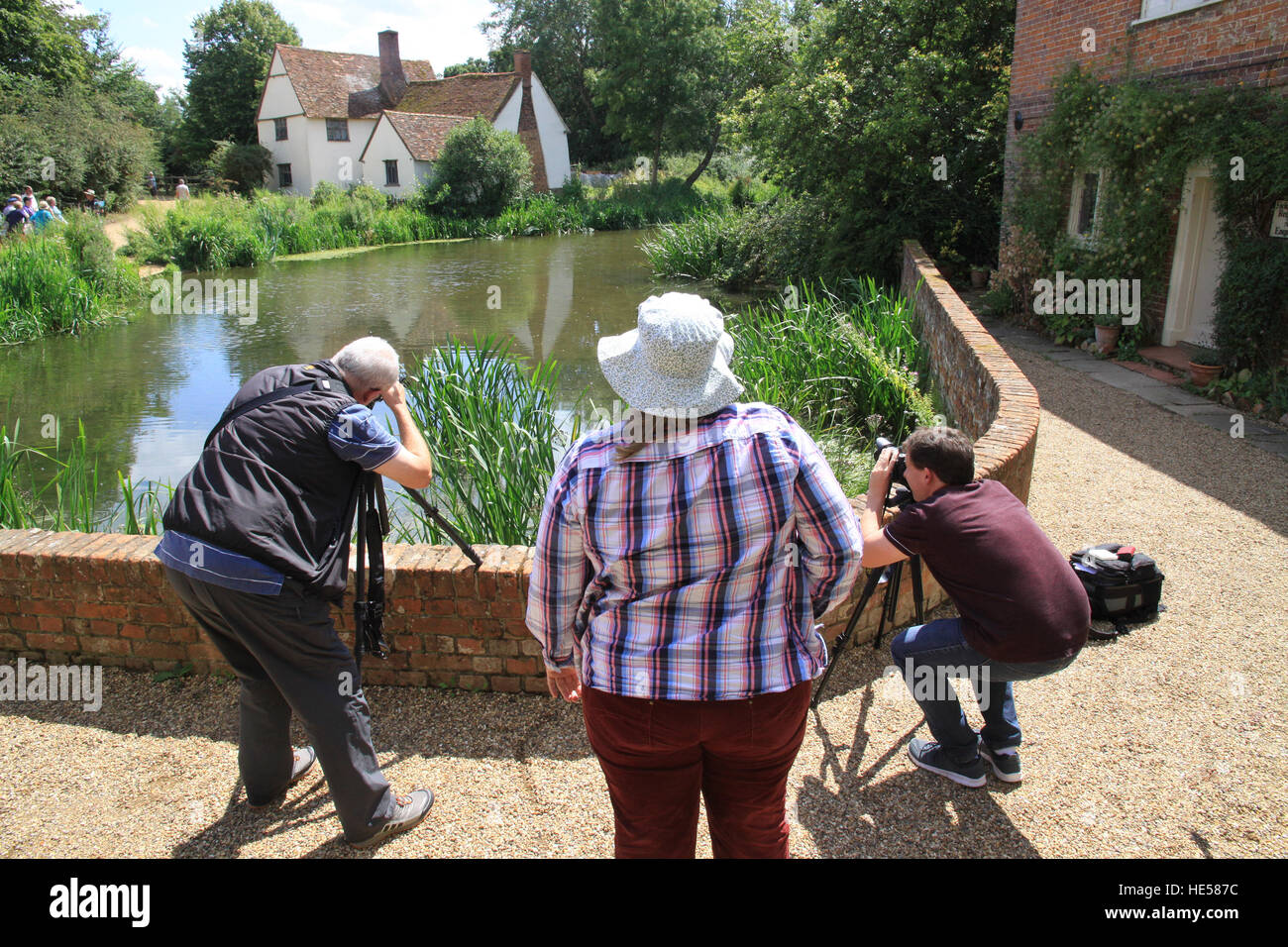 Photographers taking pictures of the location of John Constables Hay Wain with their cameras mounted on a tripod - Stock Image