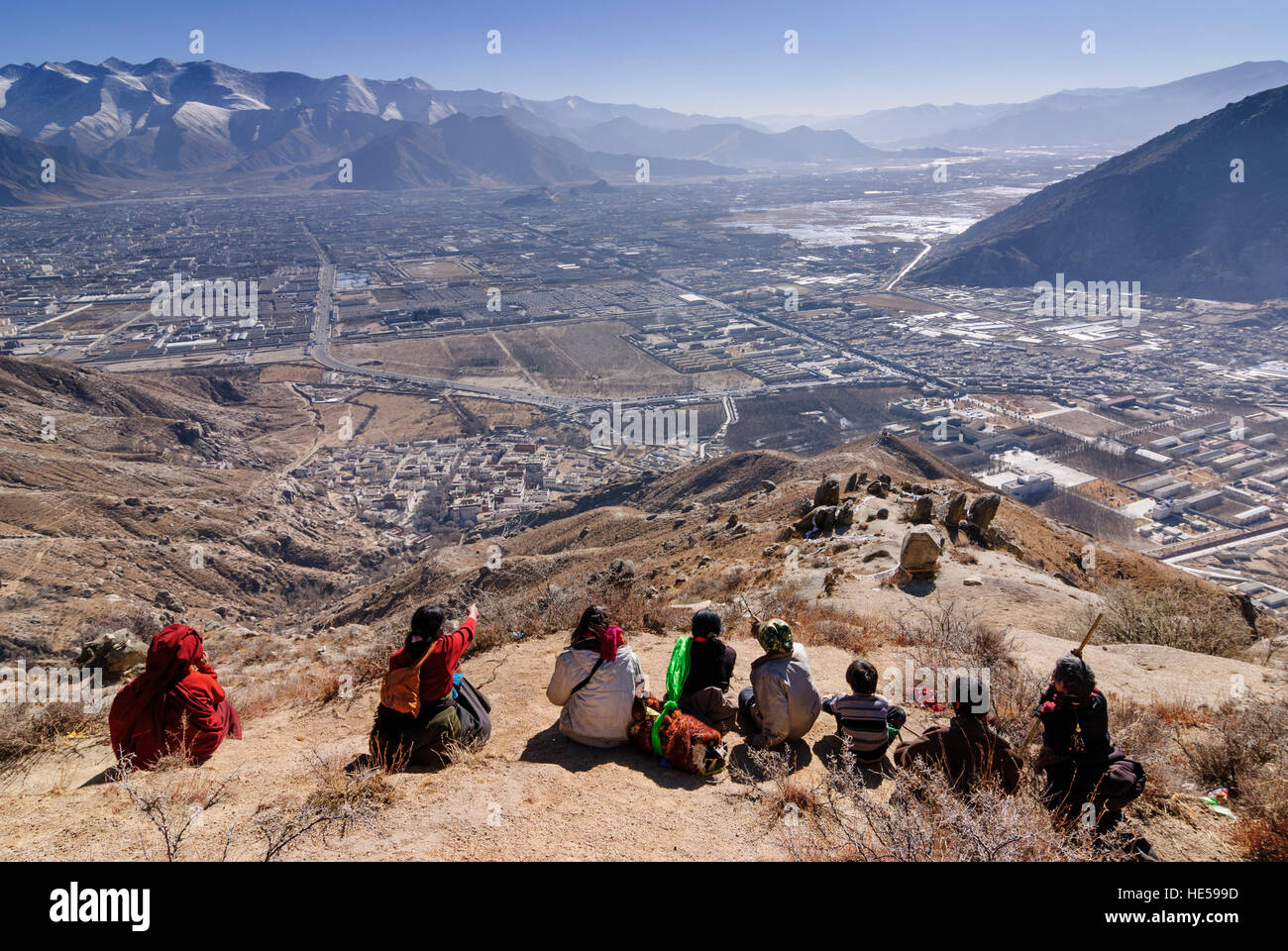 Lhasa: Tibetans look out from above the Sera monastery on Lhasa and point to the Potala, Tibet, China - Stock Image