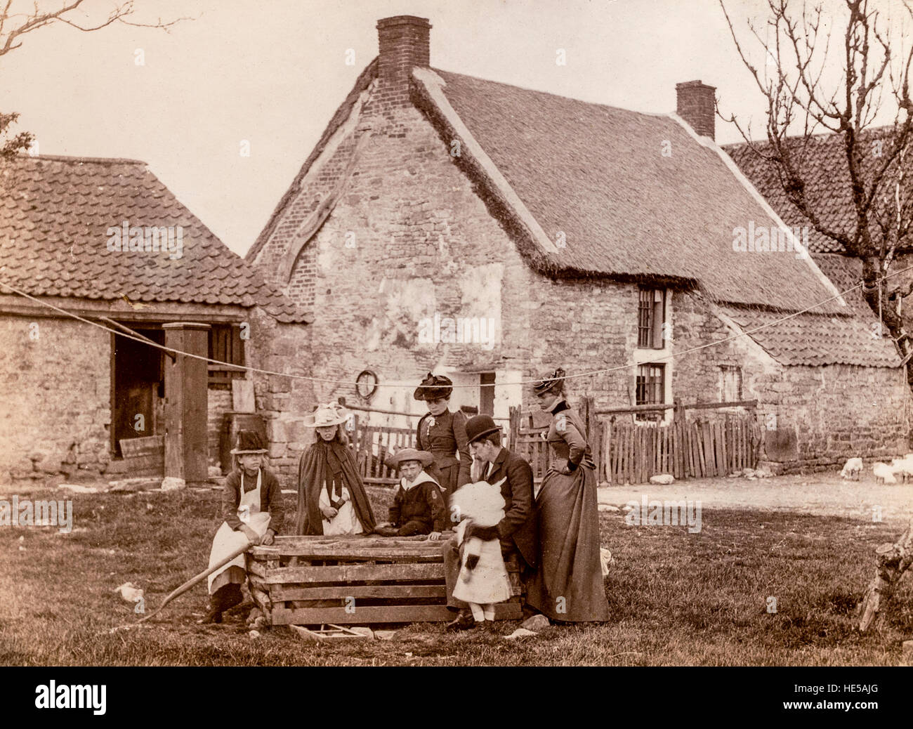 Middle class Family inspecting animals on visit to country cottage North Riding of Yorkshire UK 1906 - Stock Image