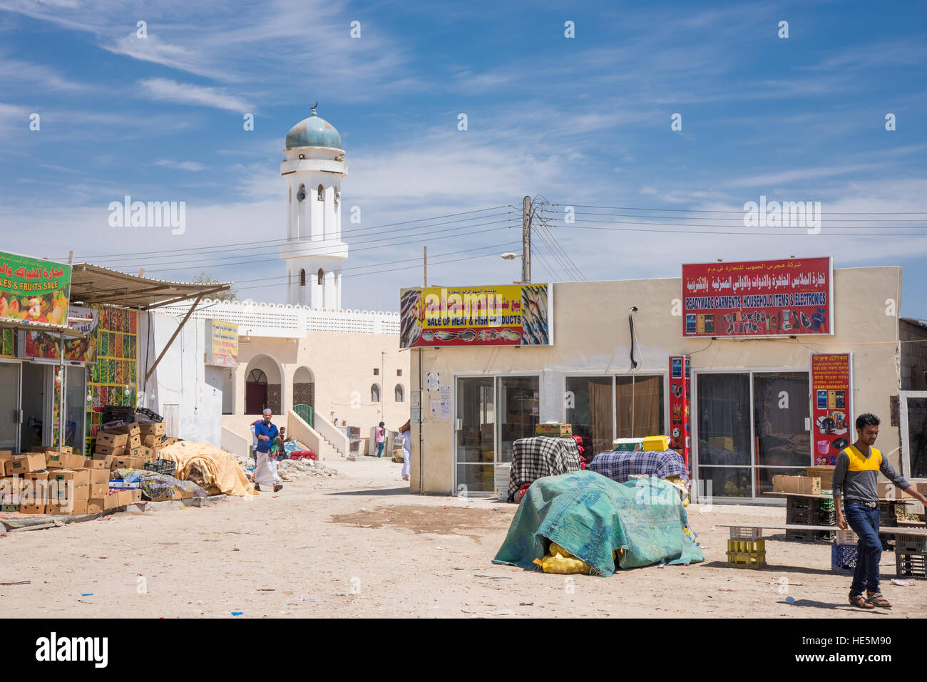 Shops and a mosque at local back roads in Salalah, Dhofar Region of Oman. - Stock Image