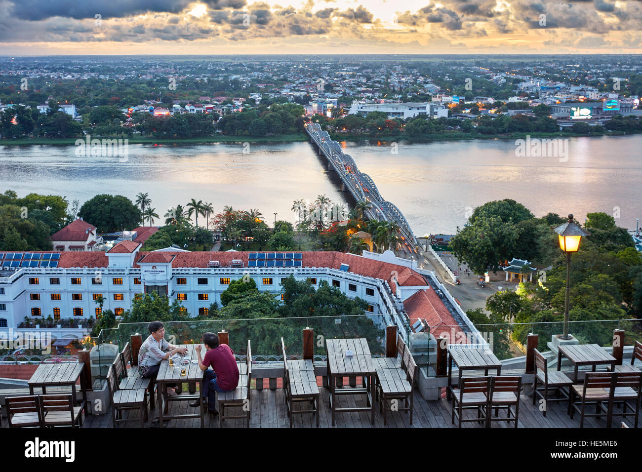 Aerial city view over the Perfume River and Truong Tien Bridge from The Imperial Hotel rooftop bar. Hue, Vietnam. Stock Photo