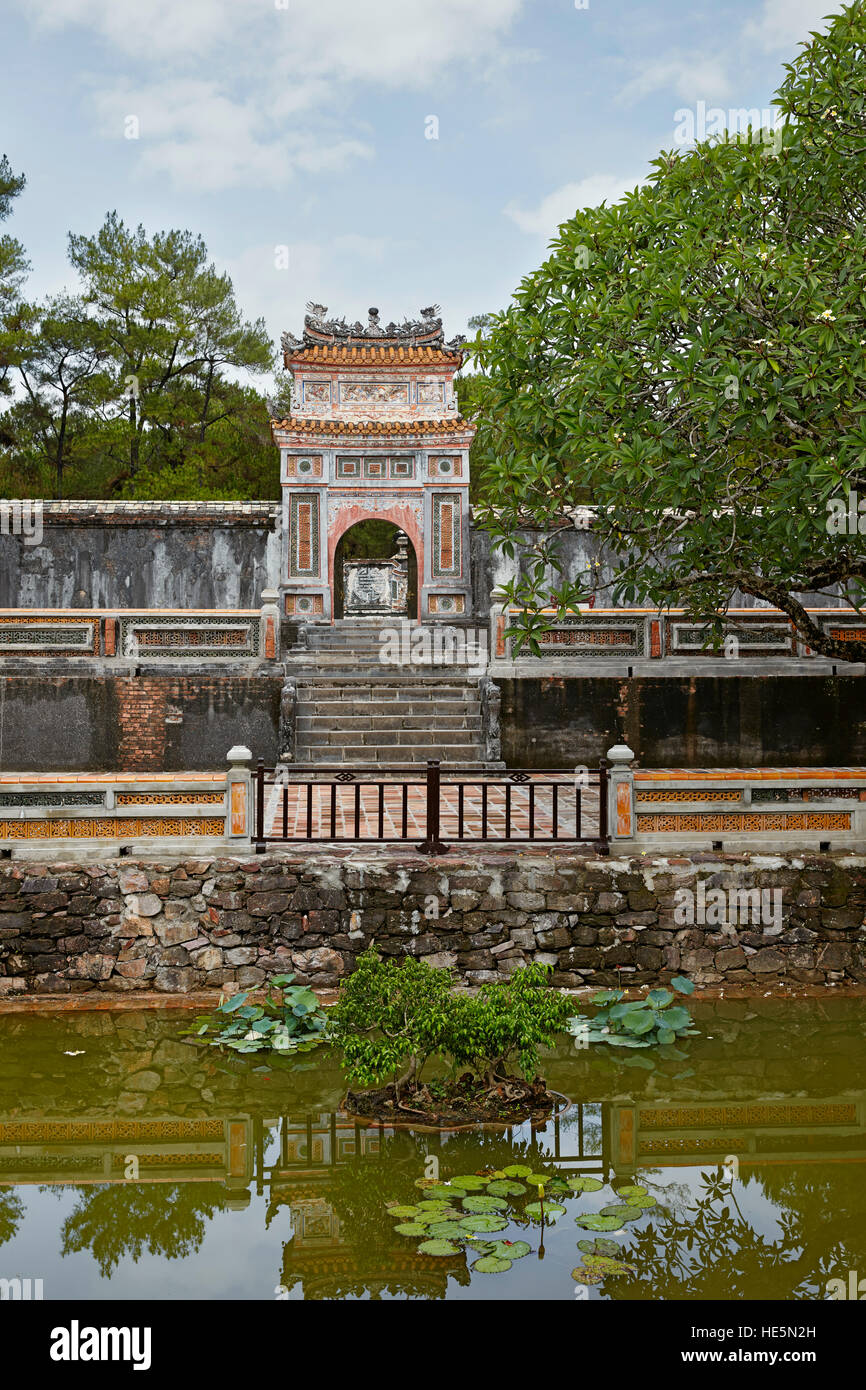 View of The Precious Wall (Buu Thanh) and entrance gate to the Royal Crypt (Huyen Cung). Tomb of Tu Duc, Hue, Vietnam. - Stock Image