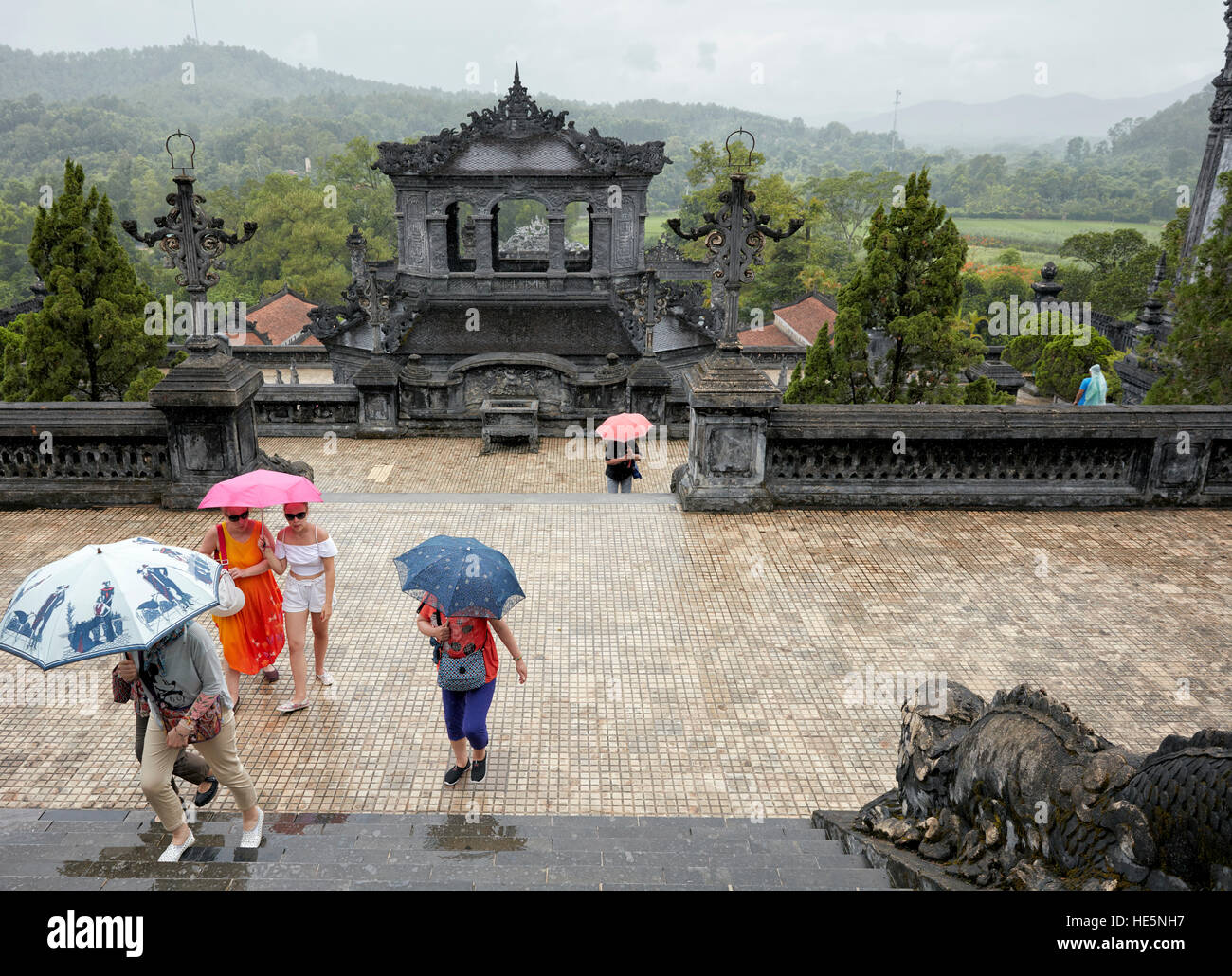 Tourists ascend from the Salutation Court to the Thien Dinh Palace. Tomb of Khai Dinh (Ung Tomb), Hue, Vietnam. - Stock Image
