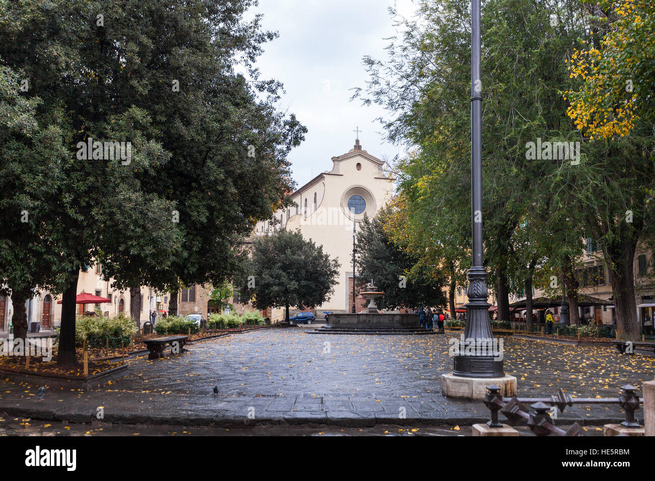 travel to Italy - Piazza Santo Spirito with fountain and Basilica di Santo Spirito in Florence city in autumn Stock Photo