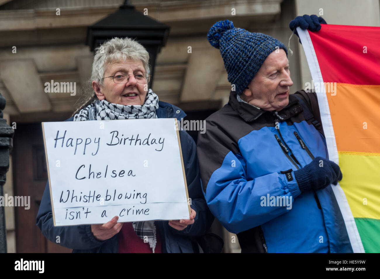 London, UK. 17th December 2016. A woman on the steps of St Martin in-the-Fields holds a poster 'Happy Birthday - Stock Image