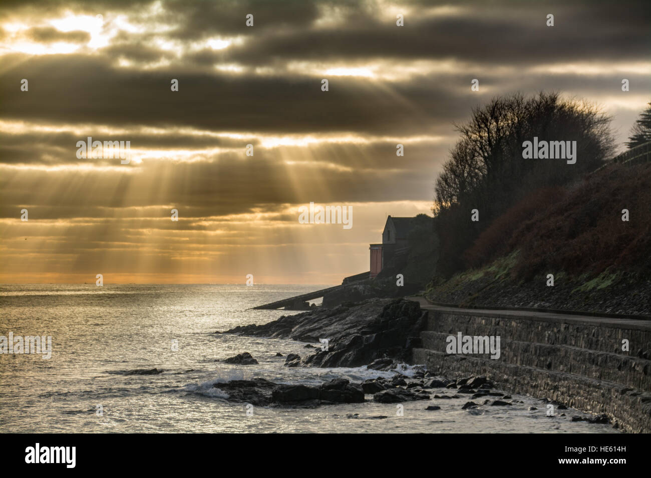 Penlee point, near Mousehole, Cornwall, UK. 18th December. UK Weather. The early morning sun shines over Mounts Stock Photo