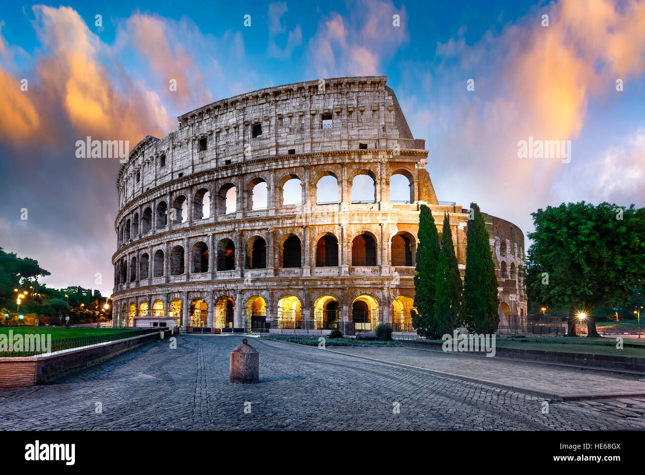 Colosseum in Rome at sunset with lights, Italy - Stock Image