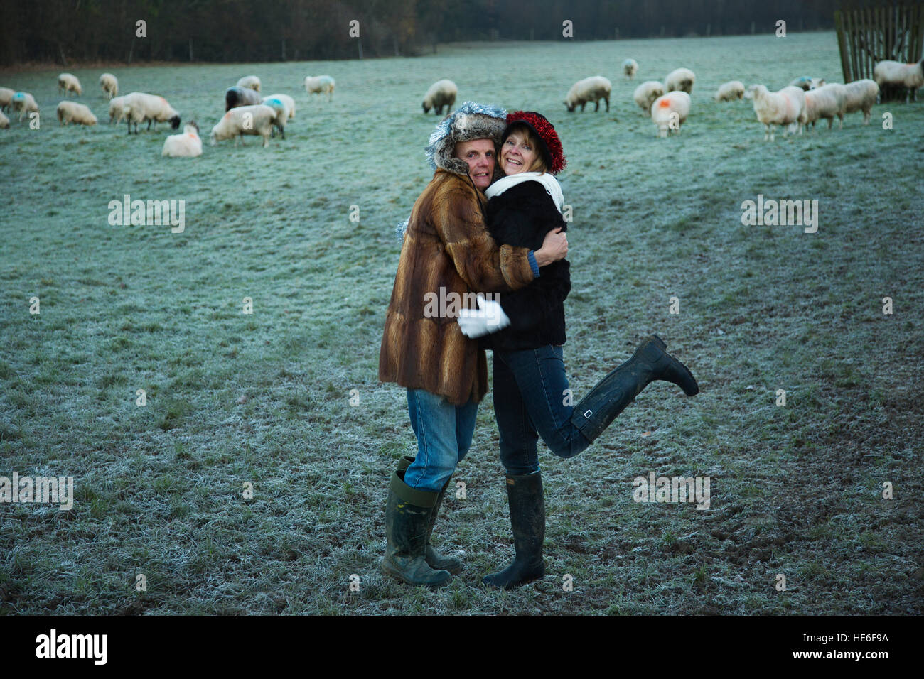 A couple waring fur coats on a frosty morning - Stock Image