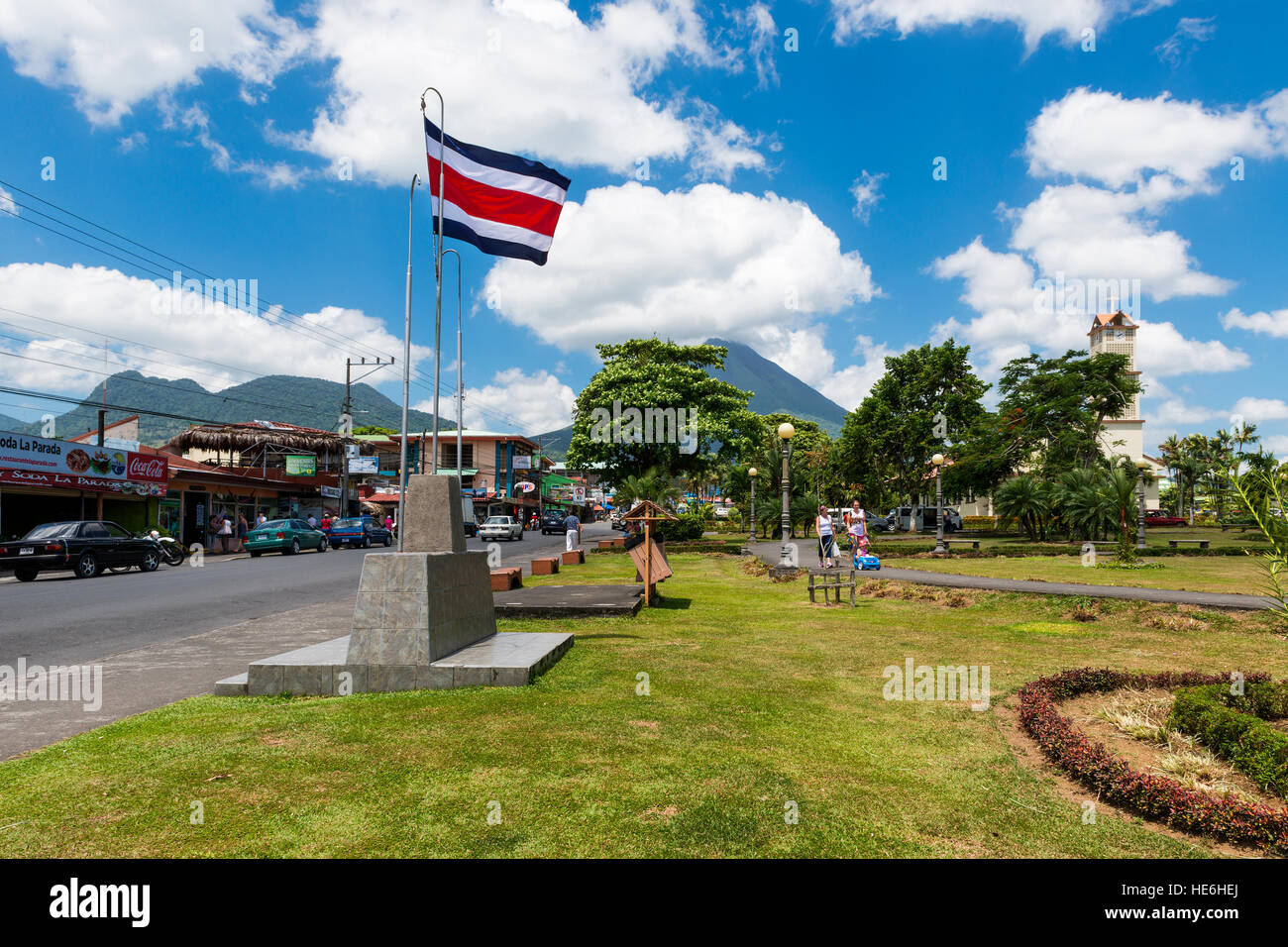 La Fortuna, Costa Rica - March 31, 2014: View of the town of La Fortuna in Costa Rica with the Arenal Volcano on - Stock Image