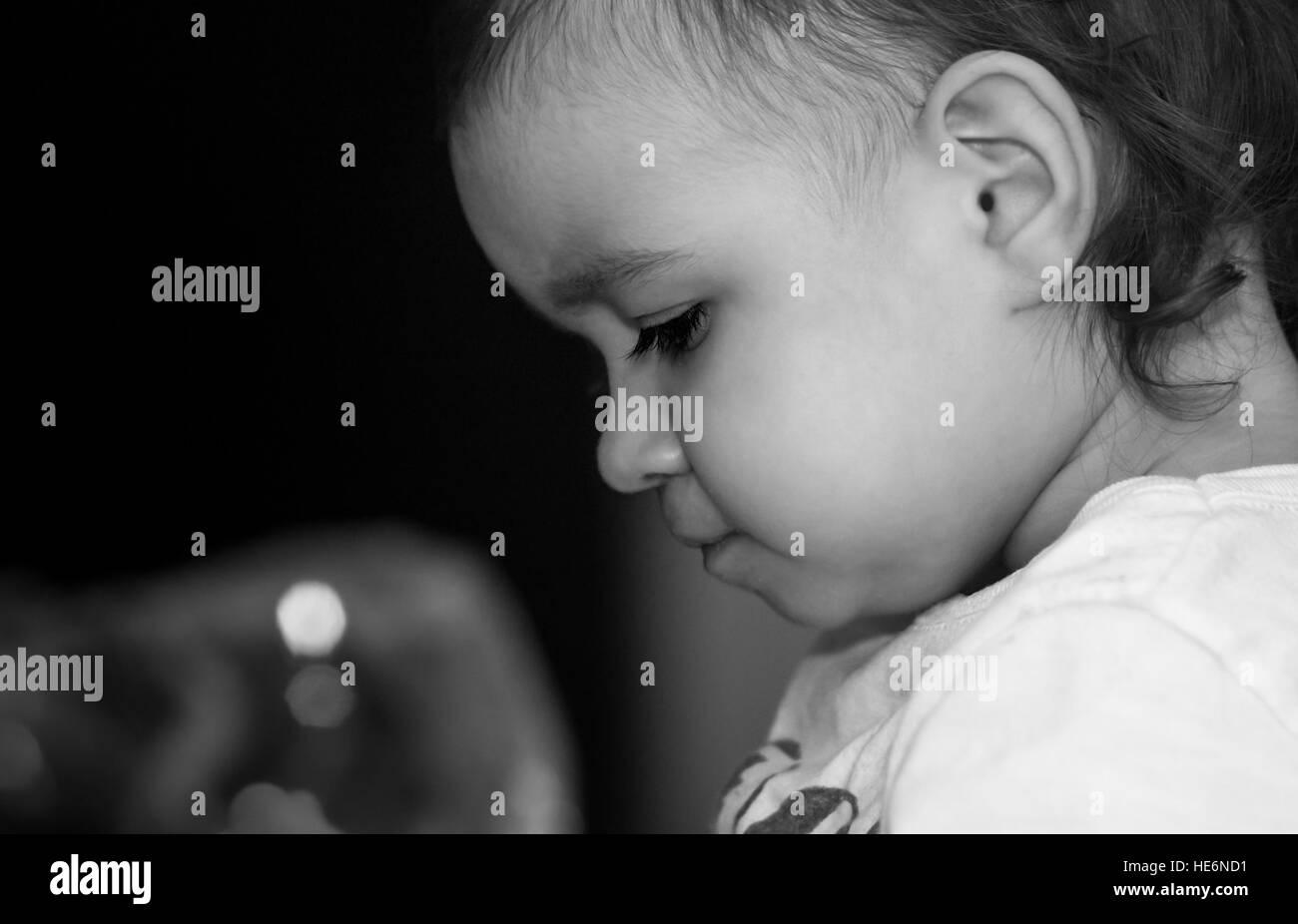 Profile face of cute little girl - Stock Image