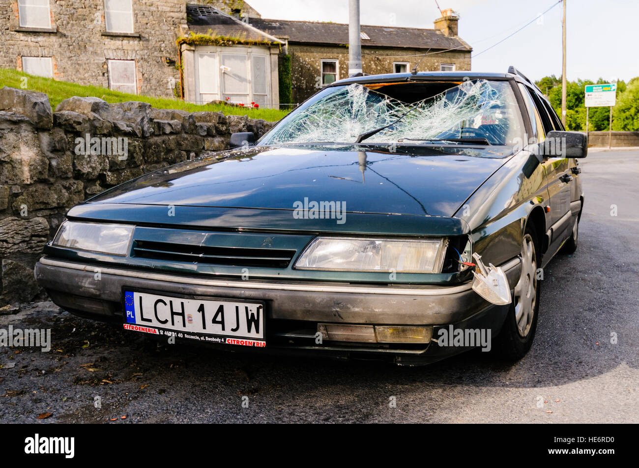 A car belonging to a Polish family is smashed up in a racist attack. - Stock Image