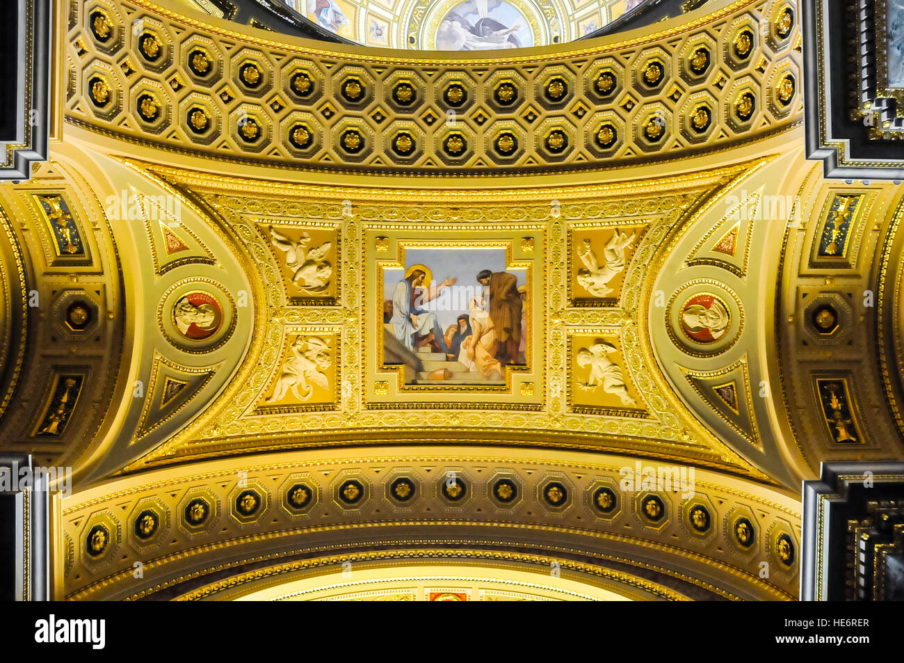 Painted plaster and guilded ceiling inside Saint Stephen's Basillica, Budapest. - Stock Image