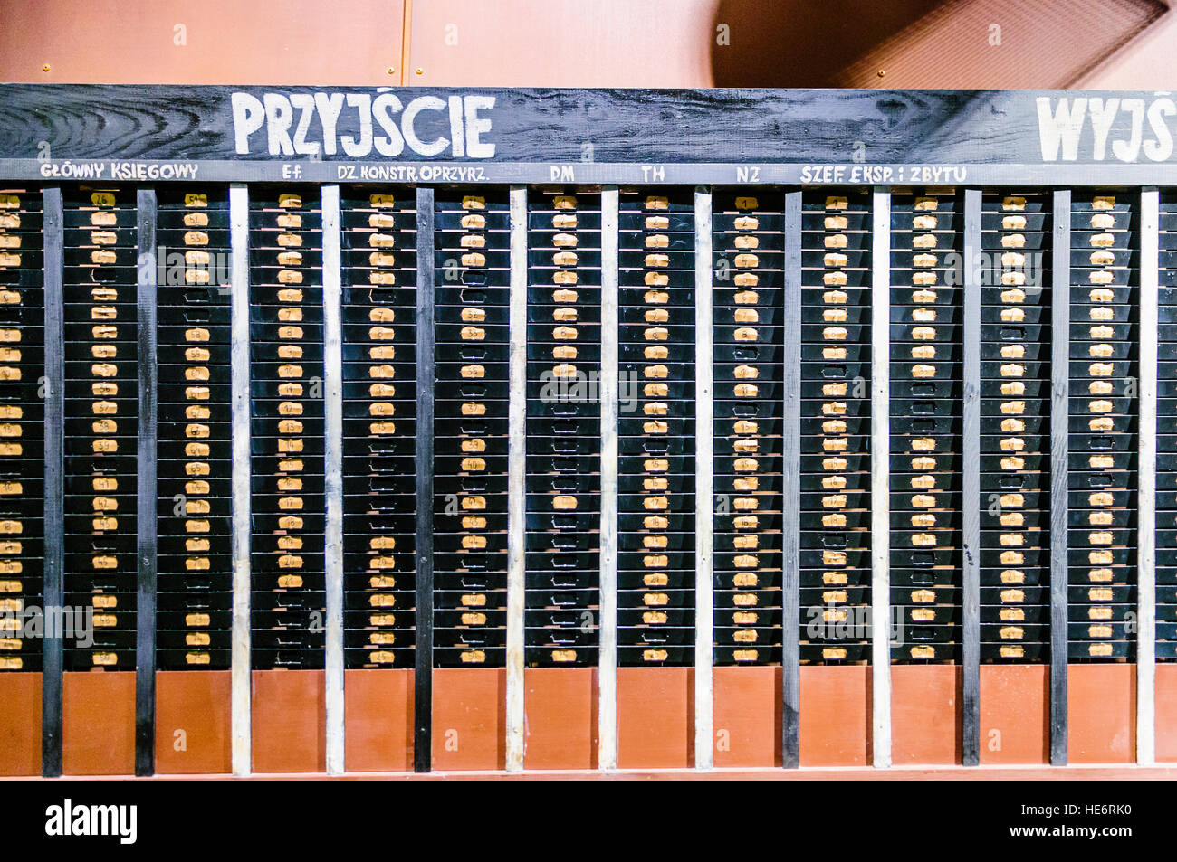 Clock-in cards and lockers used by workers in the Lenin Shipyard, in the European Solidarity Centre, Gdansk - Stock Image