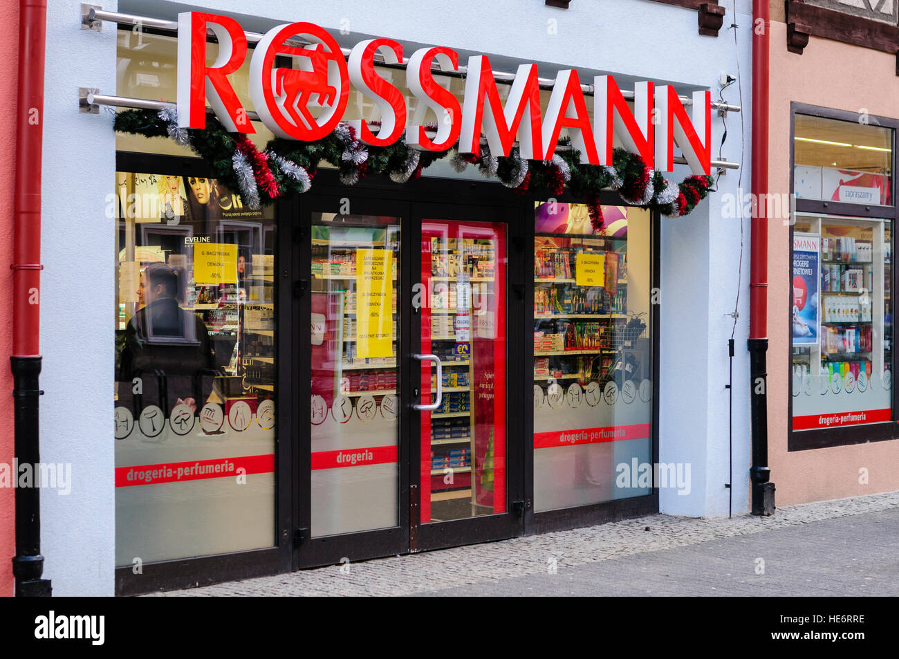 Entrance to a Rossmann store, the second largest pharmacy chain in Germany, with stores across Europe - Stock Image