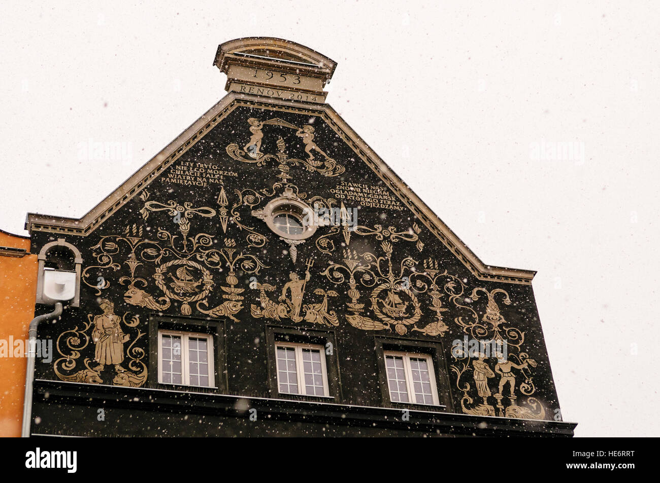 Ornately decorated spout gable wall in Dluga, Dlugi Targ, Gdansk with snow - Stock Image