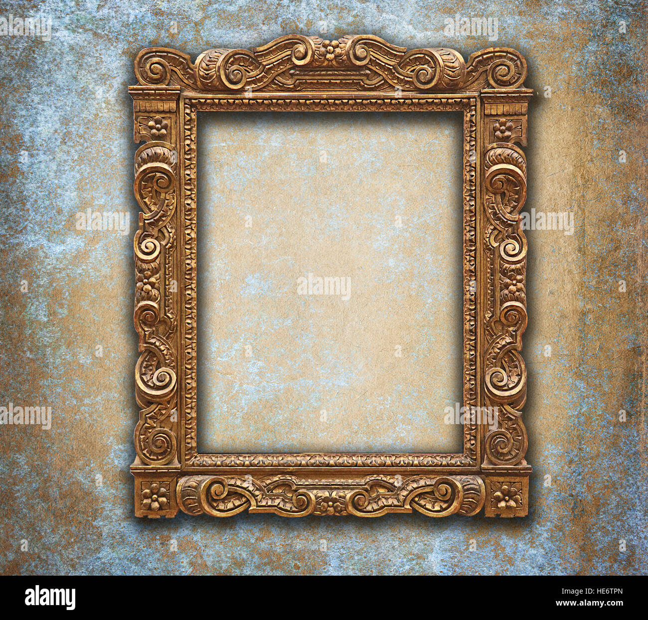 empty golden baroque frame on grunge blue and orange wall stock