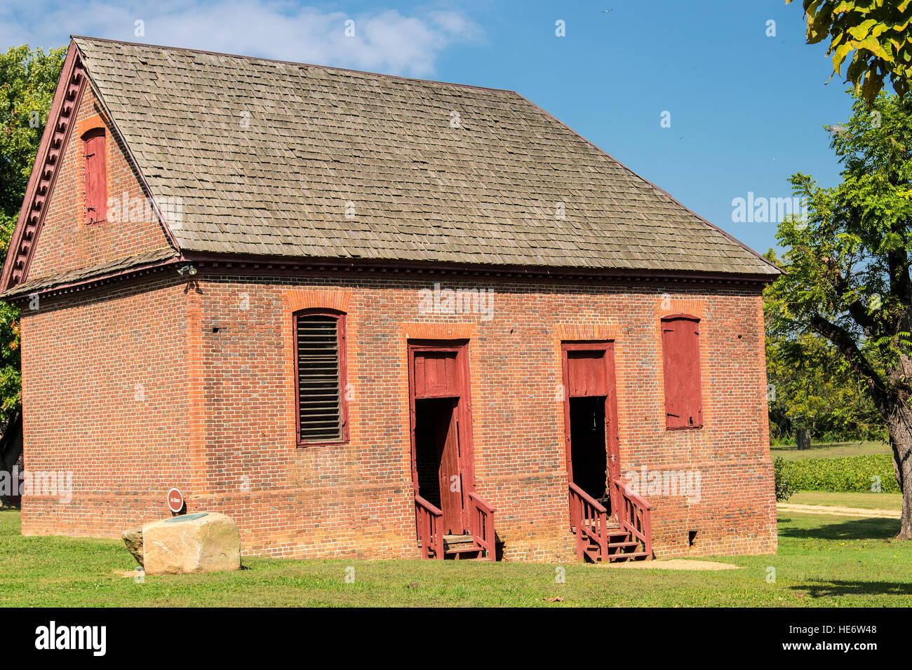 Shirley Plantation dependency building in the forecourt of the great house. - Stock Image