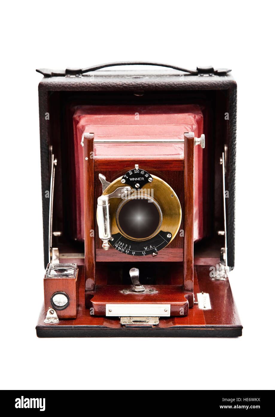 Vintage plate camera with rosewood front lens holder and folding leather bellows. - Stock Image