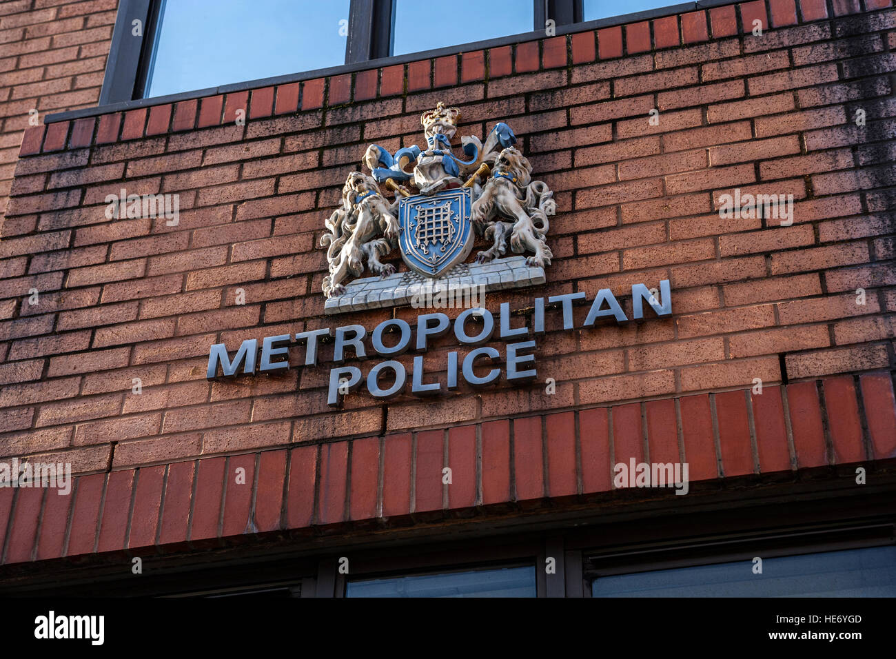 Metropolitan Police Crest on Police Station Facade - Stock Image